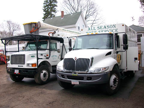 Our bucket truck and chip truck in the shop yard